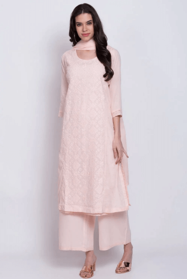 A girl wearing  pink Salwar Kameez
